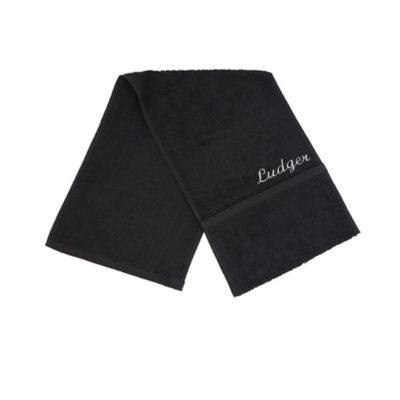 Handtuch mit Tasche für Wertsaschen und Namen von Lieblingsstücke
